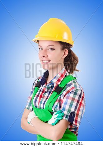 Woman builder against the gradient