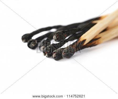 Pile of burnt match sticks isolated