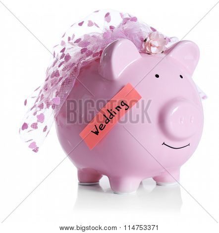 Piggy bank with wedding veil, isolated on white