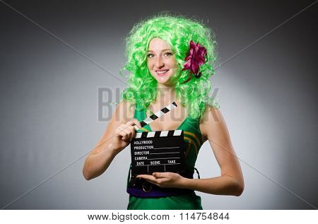 Woman with movie board in st patrick concept