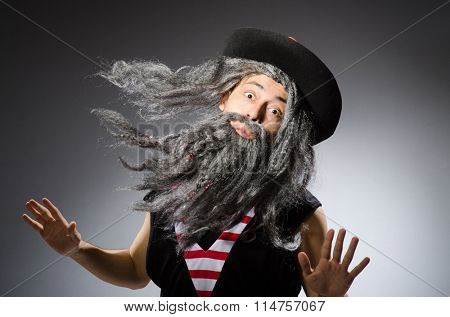 Man in pirate costume isolated on white