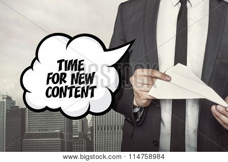 Time for new concent text on speech bubble with businessman holding paper plane in hand