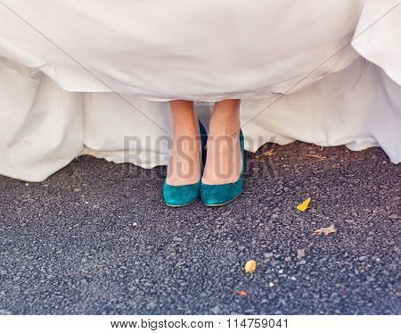 Bride  show off her turquoise shoes at wedding