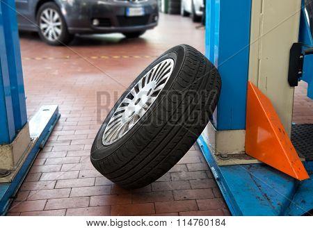 Single Car Tyre In A Workshop