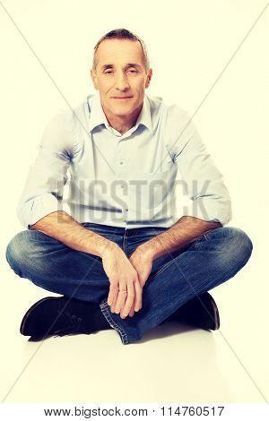 Man sitting cross-legged on the floor
