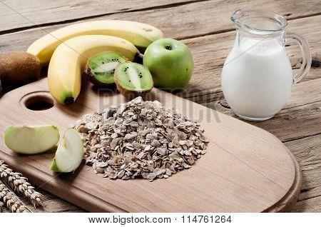 Handful Of Oatmeal With Kiwi, Apples, Bananas And Milk