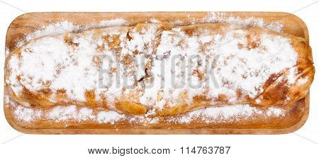 Above View Of Baked Apple Strudel On Wooden Board
