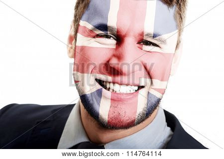 Happy man with Great Britain flag on face.