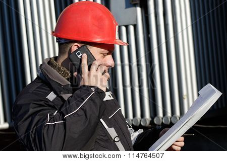 Technician In Red Helmet Make Call In Power Plant