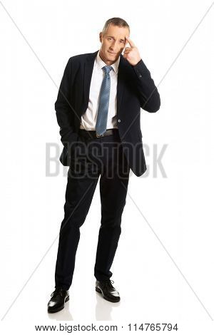 Businessman gesturing idiot sign