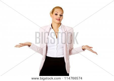 Young business woman shrugging with I dont know gesture