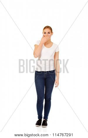 Young woman covering her mouth with hand