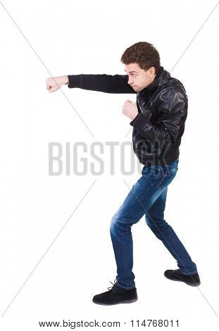 skinny guy funny fights waving his arms and legs. Isolated over white background. Man shoots with his right hand. Curly boy skillfully punches.