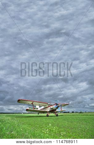 Old Biplane Takeoff Under The Storm