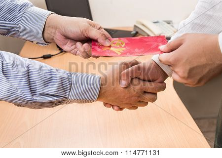 Employee Receiving Red Packet With Good Fortune Wordings, From Employer