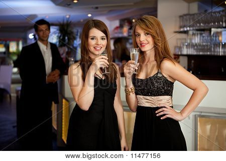 Two young women drinking chanpagne