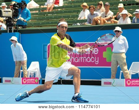Marcos Bahdatis stretches for a backhand