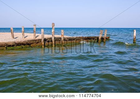 wooden pillars in the sea