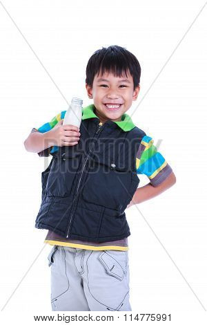 Boy Smiling And Showing Milk Holding Bottle Of Milk, Isolated On White.