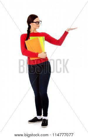 Happy student woman presenting something on open palm