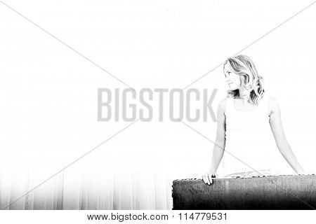 silhouette of young woman on blurred window background