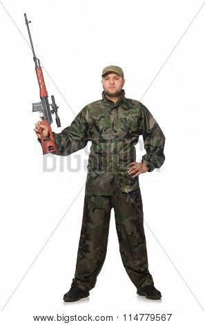 Young man in soldier uniform holding gun isolated on white