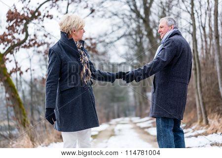 Senior woman and man saying goodbye
