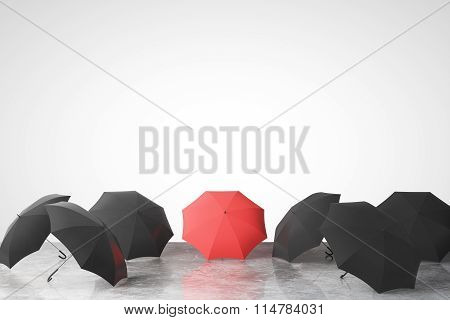 To Be Unique Concept With Many Black Umbrellas And One Red On Concrete Floor