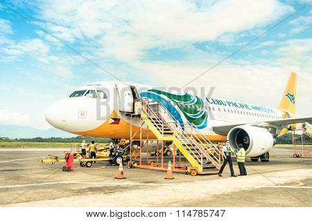 Staff People Moving Around Cebu Pacific Aircraft in Puerto Princesa Philippines