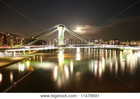 Bridge Flößerbrücke in Frankfurt with river Main