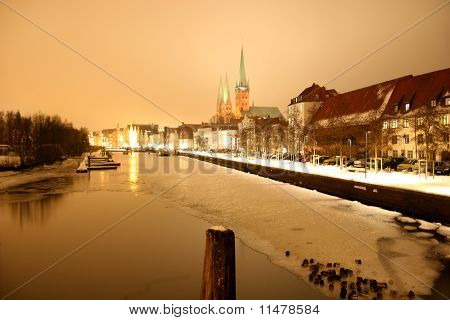 German city Lübeck and river Trave at night