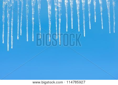 Icicles on a blue
