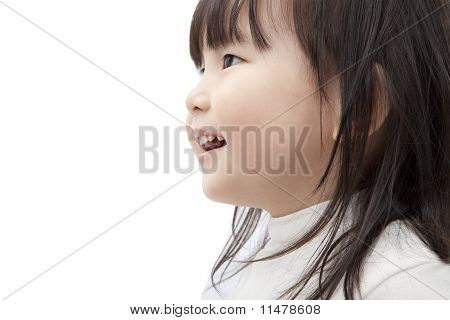 Beautiful asian little girl watch and smiling isolated on white background