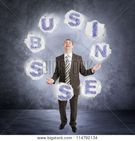 Businessman juggling word business