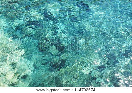 Azure clear Mediterranean sea on Santorini island.