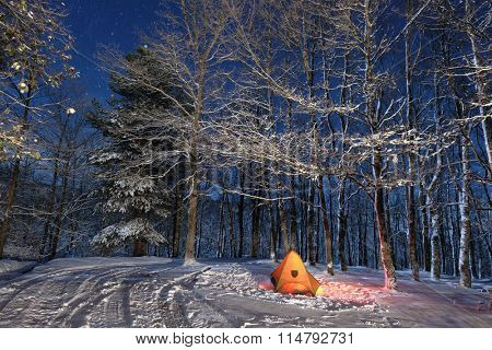 lighting tent in snowy woods of Nebrodi Park, Sicily