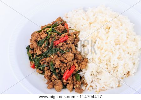 Thai stir-fried pork and basil served with rice.