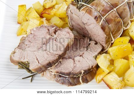 roast of veal with potatoes on dish
