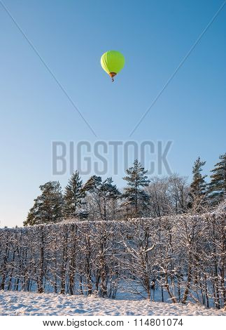 Winter landscape with a balloon