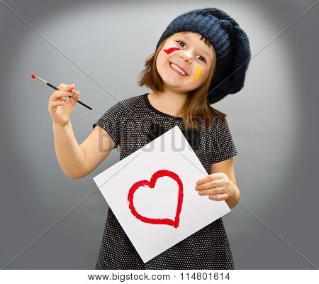Little Painter Girl With A Drwan Heart Isolated On Grey
