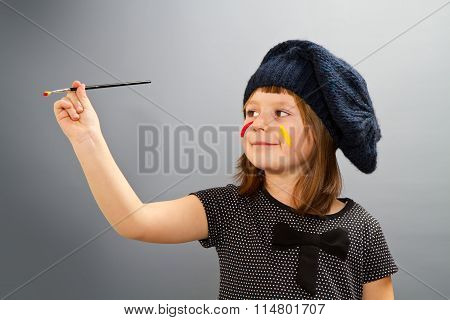 Little Painter Girl Isolated On Grey
