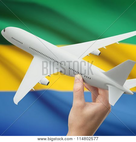 Airplane In Hand With Flag On Background - Gabon