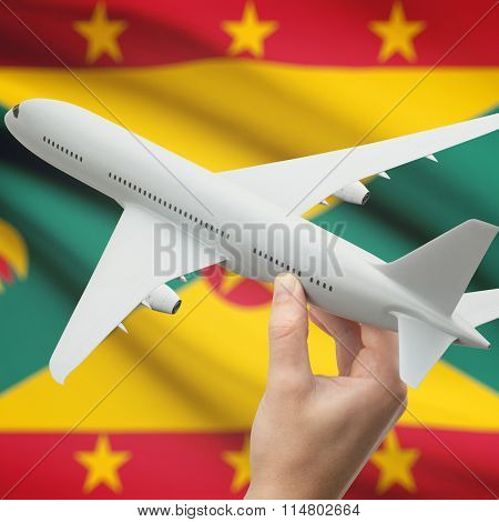Airplane In Hand With Flag On Background - Grenada