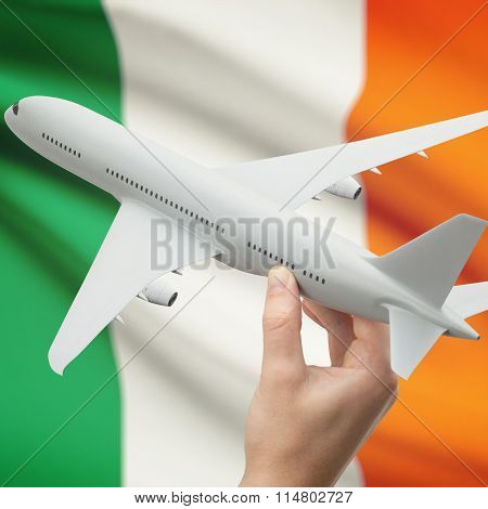 Airplane In Hand With Flag On Background - Ireland