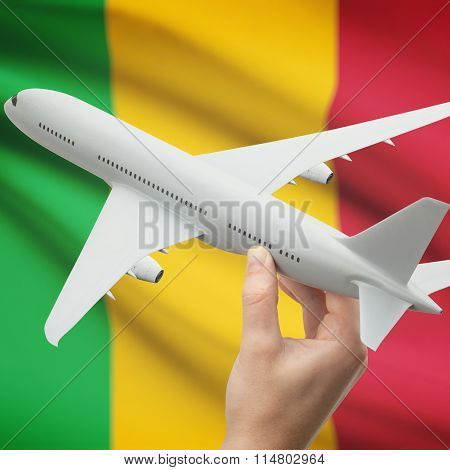 Airplane In Hand With Flag On Background - Mali