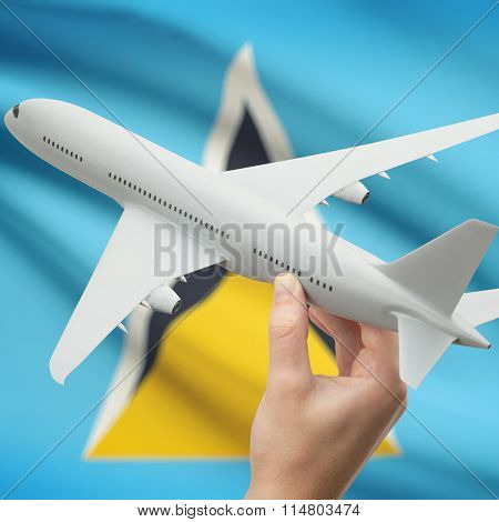 Airplane In Hand With Flag On Background - Saint Lucia