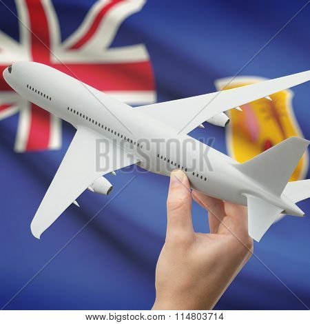 Airplane In Hand With Flag On Background - Turks And Caicos Islands