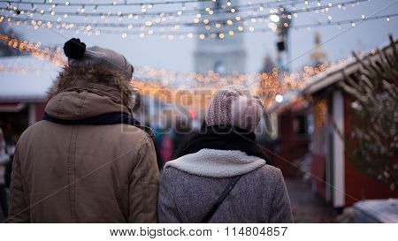 Young Couple Strolling During Winter Holidays