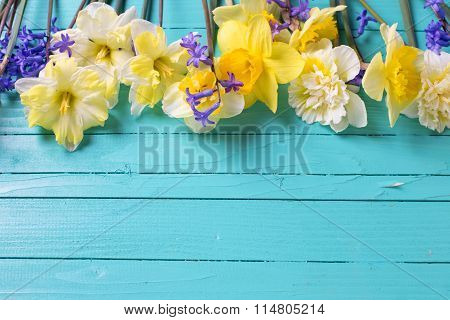 Border From Yellow And Blue Spring Flowers On Green  Painted Wooden Planks.