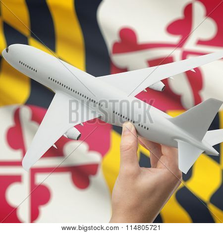 Airplane In Hand With Us State Flag On Background - Maryland